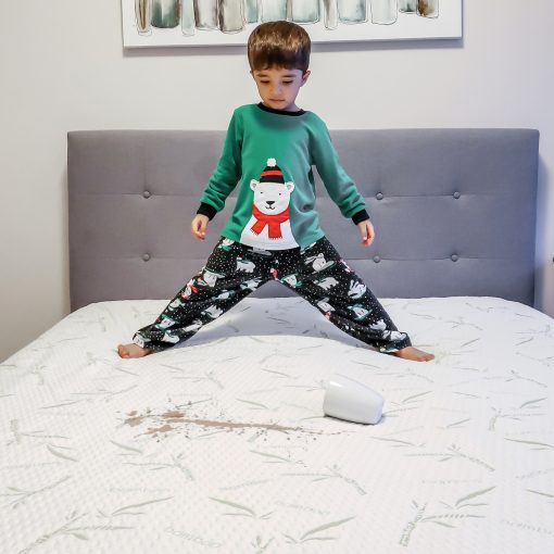 Kid spilling hot cocoa on the mattress