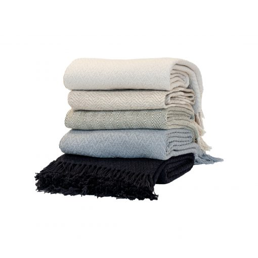 100% cotton throw by Paarizaat in a stack